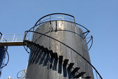 Old black storage tank — Stock Photo