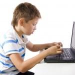 Child working on laptop — Stock Photo