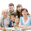Stock Photo: Happy family looking photo album
