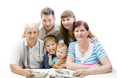 Happy family looking photo album — Stock Photo