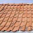 Red tile roof with gutter system and attic — Stock Photo