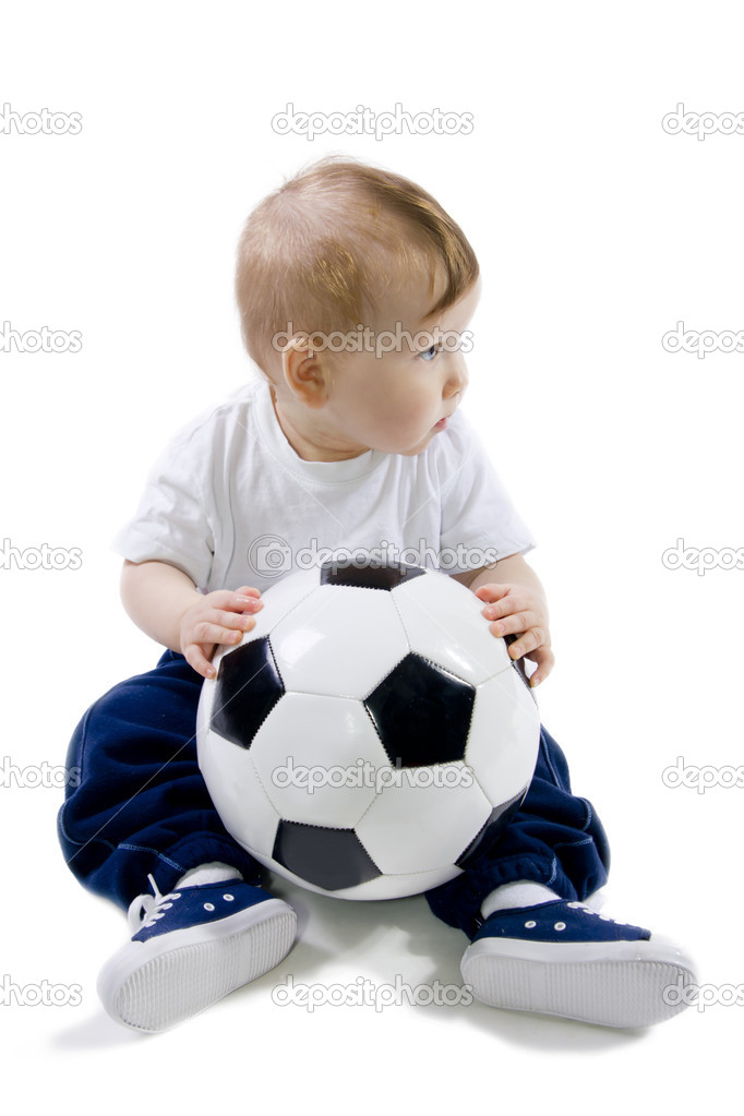 Little baby sitting in floor with football ball  Stock Photo #13778185