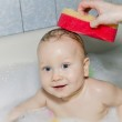 Gray-eyed Baby swimming in the bath — Stock Photo #15376975