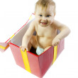 Stock Photo: Smiling Blue eyed baby in present box