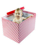 Smiling Blue eyed baby in present box — Stock Photo