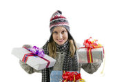 Young woman wearing a winter hat holding a Christmas presents — Stock Photo