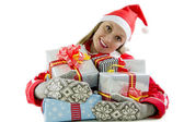 Young woman wearing a Santa hat with a Christmas presents — Stock Photo