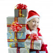 Royalty-Free Stock Photo: Boy wearing a Santa hat with a Christmas presents
