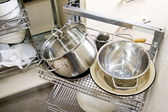 Pile of pots and pans in the cupboard — Stockfoto