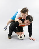 Father and son with football ball — Stock Photo