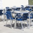Stock Photo: Empty tables of sidewalk cafe