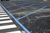 Crosswalk and parking place with road marking — Stock Photo
