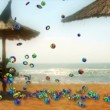 Stock Video: Colorful Objects Falling and Summer Time text against seaside and beach umbrellas