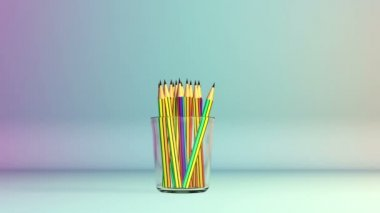 Colorful pens in studio falling into a Glass — Stock Video