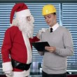 Stock Video: Santa Claus and Young Architect in a modern office, shaking hands and looking at camera