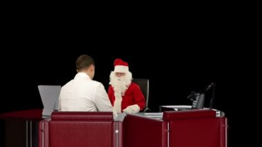 Santa Claus is sick, Doctor measuring blood pressure, against black — Stock Video