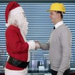 Santa Claus and Young Architect in a modern office, shaking hands and looking at camera — Stock Video