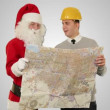 Santa Claus with a Young Architect reading a map, against white — Stock Video #17884943