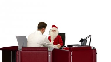 Santa Claus at Doctor, measuring blood pressure, against white — Stock Video