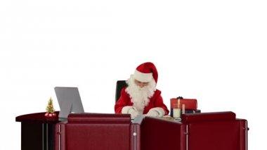 Santa Claus at work, against white — Stockvideo