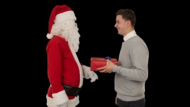 Young Businessman receiving a present from Santa Claus, shaking hands, against black — Stock Video