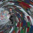 Businessman Surfing inside a Tube made of World Flags — Stock Video