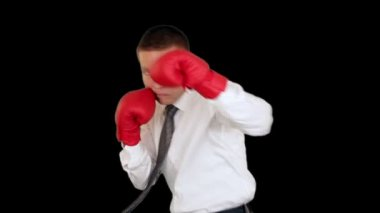 Businessman Boxing against black — Stock video