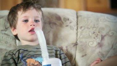 Little boy using nebulizer to inhale medicine, close up — Stock Video