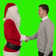 Santa Claus and Young Businessman shaking hands — Stock Video