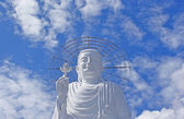 White Buddha on the background of the sky. — Stock Photo