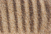 Furrows on coarse sand. — Stock Photo