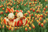 Rabbits among the tulips. — Stock Photo
