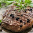 Grilled Steak with Peppercorns — Stock Photo #18125989