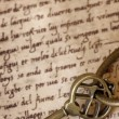 Antique Brass Key on Old Script — Photo