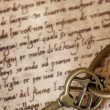Antique Brass Key on Old Script — Stock Photo #19457037