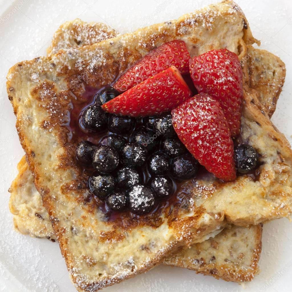 French toast with berries.  Delicious blueberries and strawberries.  Stock Photo #21267863
