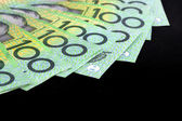 Australian One Hundred Dollar Bills over Black — Stock Photo