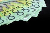 Australian One Hundred Dollar Bills over Black — Stock Photo