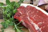 Raw Sirloin Steak with Herbs — Stok fotoğraf