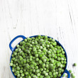 Frozen Peas in Blue Colander — Stock Photo