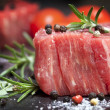 Raw Steak with Peppercorns and Herbs — Stock Photo