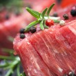 Stock Photo: Raw Steak with Peppercorns and Herbs