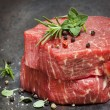 Stock Photo: Raw Beef Steaks with Herbs and Spices