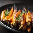 Stock Photo: Baked Baby Carrots with Thyme