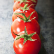Row of Truss Tomatoes on Slate — Stock Photo #40743953