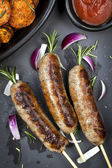 Sausages with Rosemary and Sweet Potato Fries — Photo
