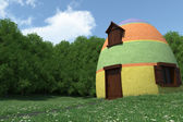 Fantasy egg house on blooming meadow — Stock Photo