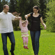 Family walking in summer park — Stock Photo
