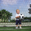 Boy with ball in gate - Stock Photo