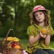 Girl with fruit in park — Stock Photo #17137185